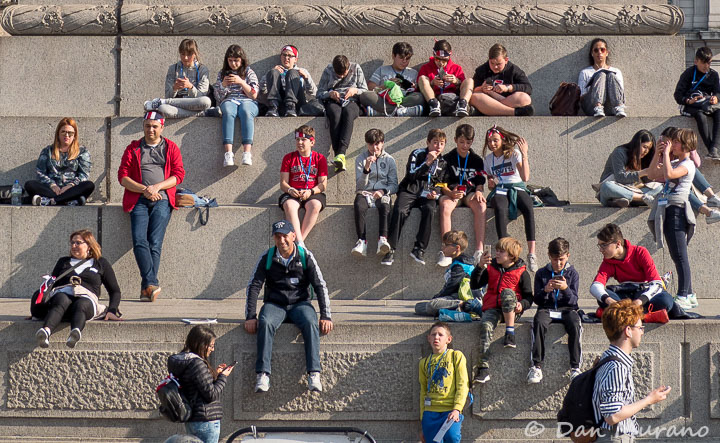 Visitors gather at the base of Nelson's column.